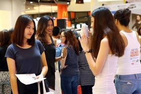 ON THE LOOKOUT: The New Paper New Face 2013 finalists picking out potential New Face girls during the Bugis+ Street Hunt last year.