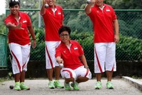 FIGUREHEAD: Vicki Heo (squatting) is Singapore's most decorated petanque player in the SEA Games, having won three bronzes.