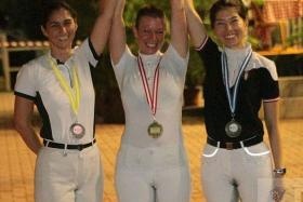 DRESSAGE FOR SUCCESS: Despite being diagnosed with cancer last September, equestrian coach Laura Richardson (centre) continued riding and working with her charges Catherine Oh (left) and Soh Wei Chi (right) in their quest for success at today's SEA Games dressage event.
