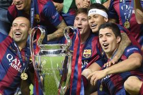 (From L)  Javier Mascherano,Lionel Messi,  Neymar and Luis Suarez celebrate with the UEFA Champions League trophy