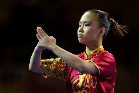 Singapore's Zoe Mui Wei Ting in action as she wins the gold