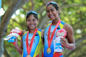 PINOY POWER: It's a one-two finish for the Philippines, as Claire Adorna (right) and Kim Mangrobang clinch the gold and silver respectively.