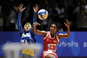 TENSE AFFAIR: There will be little to separate the Causeway rivals, after Malaysia (in blue) and Singapore (in red) battled to a 35-35 draw in the preliminary round.