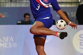 FINELY BALANCED: Cambodia's Sokphearom Ream (above) juggling his way to a gold medal in the chinlone-linking event.