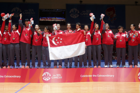 The Singapore team celebrate Gold