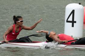 Stephenie Chen (right) and Suzanne Seah celebrate after narrowly winning the K2 500m gold medal at the 28th SEA Games.