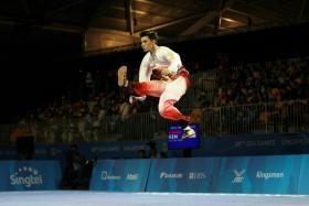 Singapore wushu captain Lee Tze Yuan competes in the men's Optional Taijiquan event at the 28th SEA Games.
