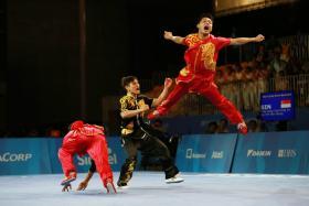 Singapore's Tay Wei Sheng, Tan Xiang Tian and Fung Jin Jie in action.