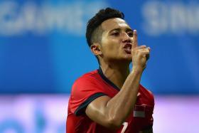 Singapore striker Sahil Suhaimi celebrates after scoring the third goal against Cambodia.