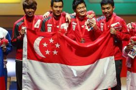 JOY: Singapore's men's foil team celebrating their win yesterday.
