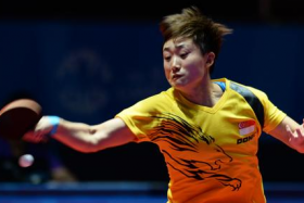 Singapore's Feng Tianwei won both her matches to help her team clinch the women's team gold medal, edging out Thailand 3-2.