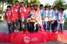 PODIUM POSE: Malaysia's Optimist team (centre) standing proud on the podium, with Singapore (left) and Thailand (right).