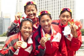GOLDEN SMILES: The women's K4 crew, from left, Geraldine Lee, Soh Sze Ying, Sarah Chen and Annabelle Ng celebrate their win at Marina Channel.
