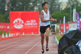 Singapore's Ashley Liew Wei Yen crossing the finishing line to place 8th in the Men's Marathon in the 28th SEA Games on 7 June 2015.