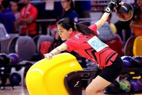 SUPER FINISH: Daphne Tan hit a solid final game score of 247 to overcome teammate Jazreel Tan for the gold medal.