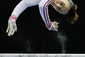 REBOUND: Malaysia's Farah Ann Abdul Hadi wins a bronze in the uneven bars despite a fall.