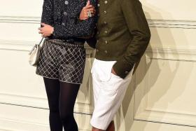 SNAZZY: Pharrell Williams and wife Helen Lasichanh at the Chanel Paris-Salzburg 2014/15 Metiers d'Art Collection in March.