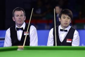 LOSS FOR WORDS: Singapore's English billiards doubles pair Peter Gilchrist (left) and Chan Keng Kwang (right) wondering how they let a 90-48 lead slip in the final frame.