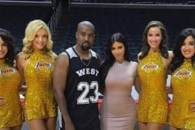 Kanye West celebrates his birthday with wife Kim Kardashian (both middle) at Staples Center, USA.