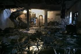BURNT: The stairwell was on fire, so the maid helped the oldest occupant escape through a window.