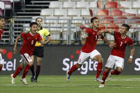 Indonesia players celebrating a goal during their game against Cambodia on June 6.