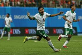 Indonesia's Evan Dimas celebrates after scoring against Singapore during the group stage of the SEA Games football tournament.