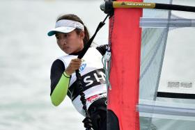 PROUD: Audrey Yong (above) emerges victorious in the women's RSX windsurfing event.
