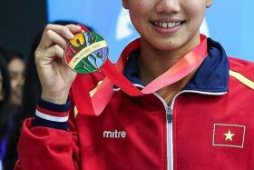 IRON LADY: Vietnam's Nguyen Thi Anh Vien (above) was initially registered to take part in 13 individual swimming events.