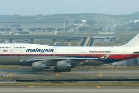 FILE PHOTO: A Malaysian Airlines flight was forced to make an emergency landing in Melbourne, Australia after aircraft systems indicated an engine fire.