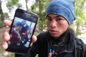Mount Kinabalu guide Mohd Rizuan Kauhinin will travel to Singapore to meet the boy he rescued.