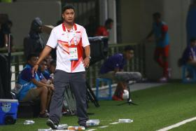 Aide Iskandar, walking the touchline when Singapore took on Indonesia. He announced after the games that he was walking away from the role as coach.