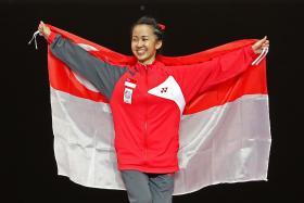 Chelsea Sim celebrates gold