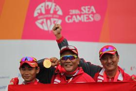Singapore's Lin Hejun, Amat Mohd Zain and Choo Choon Seng celebrate with their gold medals.