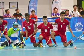 DOMINANT START: Singapore floorball men and women's teams (in red) prove too mighty for rivals the Philippines and Malaysia respectively.