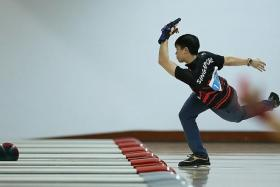 """""""They lost the gold by just over 40 pins and they really have the belief in themselves. they have worked really hard and all the hard work is paying off."""" - Singapore Bowling Federation president Jessie Phua on Javier Tan (above) and his teammates in the men's trios"""