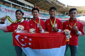 GOLDEN HOPES: (from left) Muhammad Amirudin Jamal, Calvin Kang, Muhammad Elfi Mustapa and Lee Cheng Wei posing with their silver medal at the 2013 SEA Games in Naypyidaw, Myanmar.