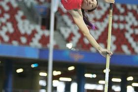 SILVER LINING: Singapore's Rachel Yang (above) breaks her own national record in the women's pole vault event, after coming in second.