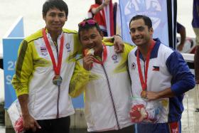 WINNERS: Thailand's Padiwat Jaemjan (centre) celebrates winning the gold medal with compatriot Tatsanai Kuakoonrat (left) and the Philippines' bronze medallist Mark Howard Griffin (right)
