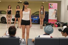 JUDGES: New Face 2012 winner Sharin Keong (above) at her audition and other judges Eunice Annabel Lim, Mr Ian Lee and Mr Dollah Jaafar.