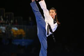HIGH KICK: Chelsea Sim wowing her way to the individual poomsae gold yesterday.
