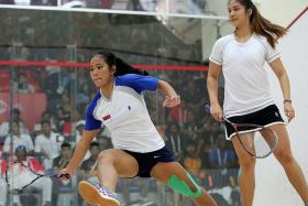 VICTOR AND VANQUISHED: Malaysia's Rachel Arnold (above, right) on her way to beating Indonesia's Catur Yuliana, and Singapore's Vivian Rhamanan after his defeat.