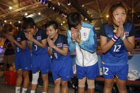GOLDEN GIRLS: The Thailand team (above) bow to fans after winning the women's sepak takraw regu final against Myanmar.