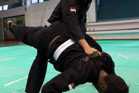 Alfian Juma'en (above) has won gold for Singapore in the men's tanding Class F (70-75kg).