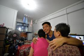 MAN OF THE HOUSE: (above) Mr Lu Zhi Quan works as a part-time cleaner to support his mother and sister (in pink).