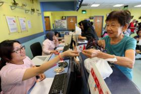 Pioneer Generation cardholders like  Madam Tjong Tjie Moi (in her 70s) will get letters about Medisave top-ups.