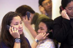 FILE PHOTO: Local telcos will stop providing 2G services in 2017.