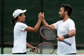 ALMOST A CLEAN SWEEP: If not for the Philippines' tennis pair of Denise Dy (left) and Treat Huey (right), Thailand would have won all the golds on offer at a SEA Games for the first time.