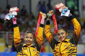 MIRACLE: Koi Sie Yan (left) and Shasangari S Nagarajan are overjoyed at finishing first together.
