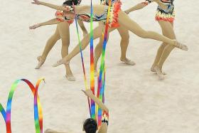 FANTASTIC FIVE: Singapore's gymnasts impressing in their routine yesterday.