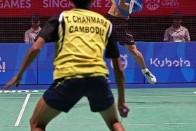 FLYING HIGH: Singapore's Loh Kean Yew (above) coasting to an easy victory over Cambodia's Chanmara Tep).